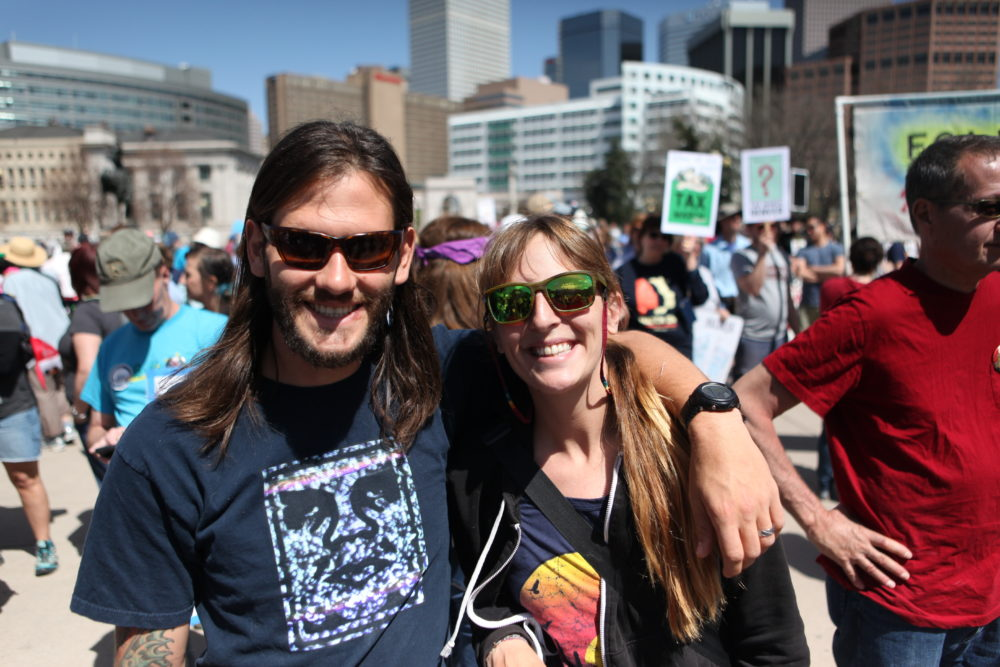 Mike Wagner and Erika Casorso at the Tax Day march in Civic Center (Andrew Kenney/Denverite)