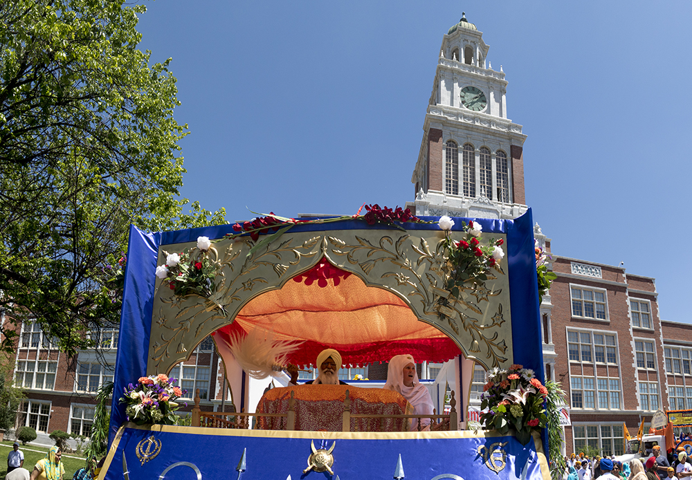 A guru's seat has been set up on a flatbed that will process down Colfax Avenue. The second-annual Sikh festival at East High School, May 28, 2017. (Kevin J. Beaty/Denverite)  sikh; colorado singh sabha; east high school; denver; colorado; parade; kevinjbeaty; denverite;