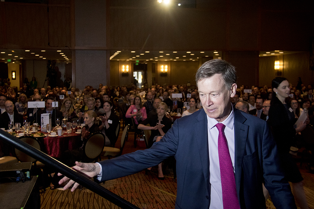 Governor John Hickenlooper takes the stage at the Denver Metro Chamber of Commerce's State of the State luncheon, May 11, 2017. (Kevin J. Beaty/Denverite)  chamber of commerce; downtown; colorado; denver; denverite; kevinjbeaty; governor john hickenlooper;
