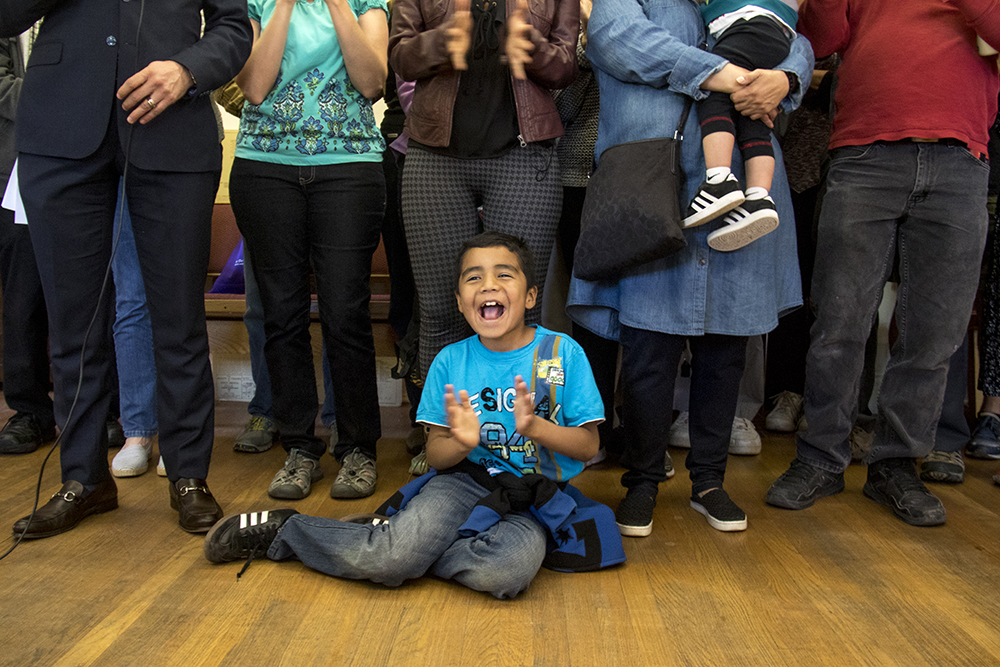 Ingrid Encalada Latorre's son Bryant cheers as his mom announces that she's leaving sanctuary, May 20, 2017. (Kevin J. Beaty/Denverite)  immigration; ingrid encalada latorre; deportation; undocumented; sanctuary; kevinjbeaty; denver; denverite; colorado;