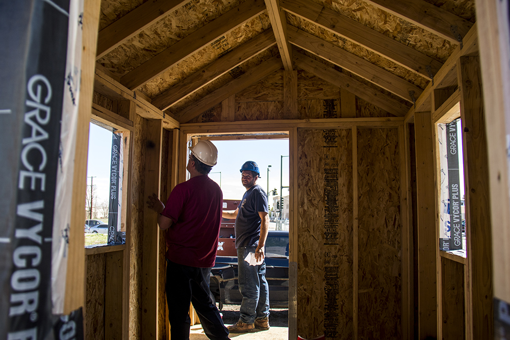 Paul (left) and Steel Ethridge inspect the first completed tiny house. Construction on the Beloved Community Village begins at Walnut and 38th streets, May 20, 2017. (Kevin J. Beaty/Denverite)  homeless; right to rest; tiny home village; rino; five points; denver; denverite; colorado; kevinjbeaty;