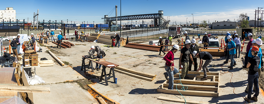 Construction on the Beloved Community Village begins at Walnut and 38th streets, May 20, 2017. (Kevin J. Beaty/Denverite)  homeless; right to rest; tiny home village; rino; five points; denver; denverite; colorado; kevinjbeaty;