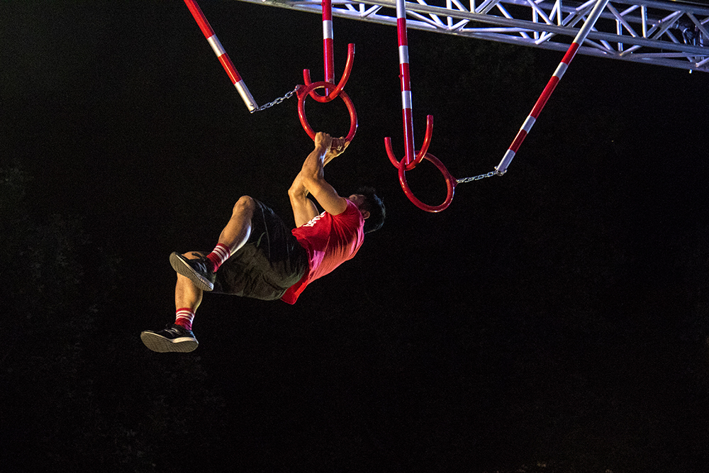 Dan Yager runs the American Ninja Warrior course during the finals shoot in front of the City and County Building, May 25, 2017. (Kevin J. Beaty/Denverite)  american ninja warrior; civic center park; denver; denverite; colorado; kevinjbeaty