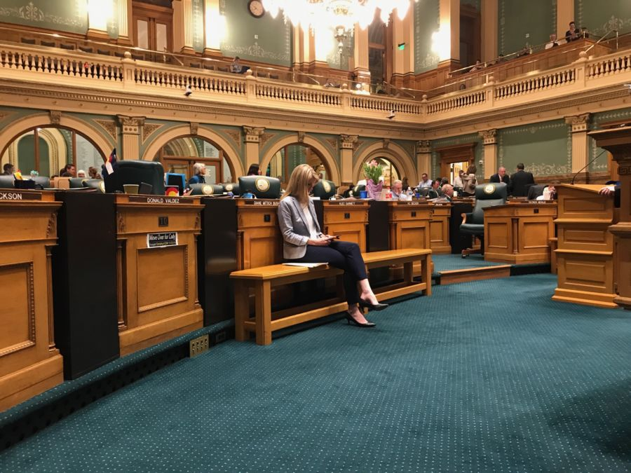 State Rep. Brittany Pettersen, a Lakewood Democrat, sits alone on the House of Representatives floor as members of her own party filibustered her compromise on charter school funding. (Nicholas Garcia/Chalkbeat)