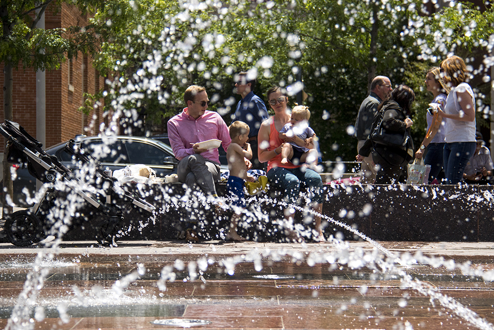 The Frei family plays by Union Station's fountains. (Kevin J. Beaty/Denverite)  summer; cowx; weather; union station; swimming; denver; denverite; colorado; kevinjbeaty