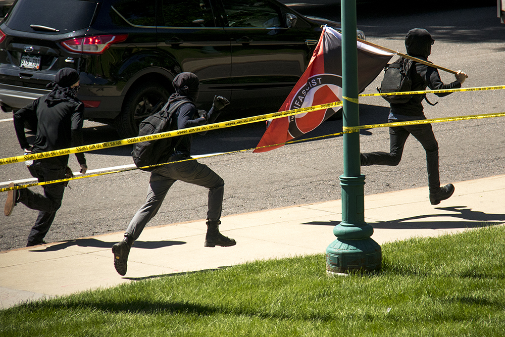 Anarchist protesters sprint away from pursuing police officers. A rally against Sharia law atop the Capitol steps, June 10, 2017. (Kevin J. Beaty/Denverite)  copolitics; rally; protest; sharia law; islamophobia; kevinjbeaty; denver; colorado; denverite;