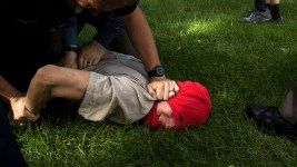 Two anarchist protesters are thrown to the ground and detained by police after they tried to start a fight with bikers leaving the park. A rally against Sharia law atop the Capitol steps, June 10, 2017. (Kevin J. Beaty/Denverite)  copolitics; rally; protest; sharia law; islamophobia; kevinjbeaty; denver; colorado; denverite;