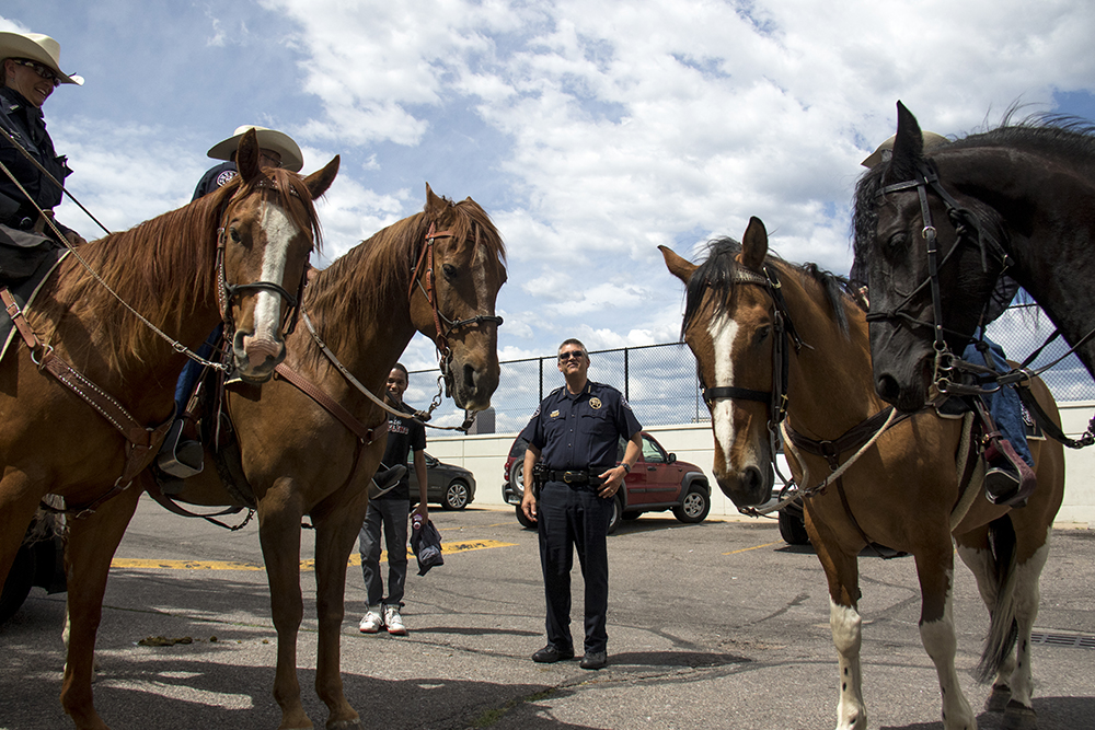 Denver Sheriff Patrick Firman among his mounted deputies. The Juneteenth parade in Five Points, June 17, 2017. (Kevin J. Beaty/Denverite)  juneteenth; five points; black history; kevinjbeaty; denver; colorado; denverite; street fair; festival; welton street;