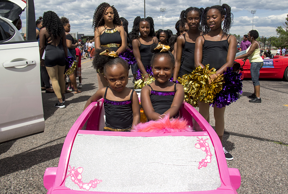 Azatiy and Teaionna ride in a pink Escallade. The Juneteenth parade in Five Points, June 17, 2017. (Kevin J. Beaty/Denverite)  juneteenth; five points; black history; kevinjbeaty; denver; colorado; denverite; street fair; festival; welton street;