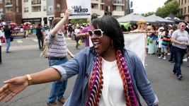 District 8 Rep. Leslie Herod greets supporters. The Juneteenth parade in Five Points, June 17, 2017. (Kevin J. Beaty/Denverite)  juneteenth; five points; black history; kevinjbeaty; denver; colorado; denverite; street fair; festival; welton street;