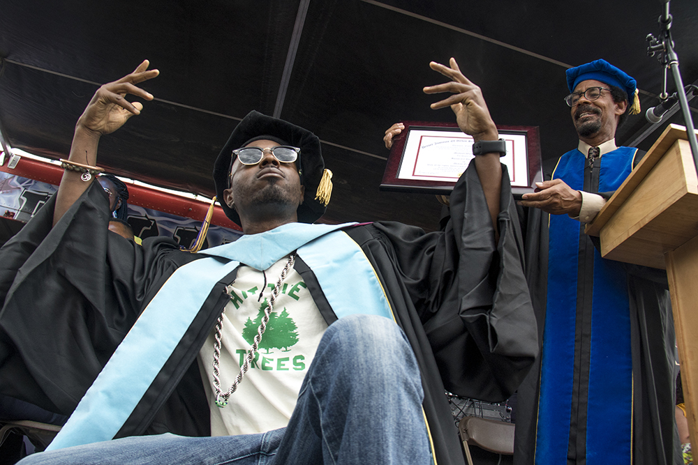 Michael Walker, AKA DJ Cavem, is presented with an honorary doctorate degree from the Denver Institute of Urban Studies and Adult College for his work on healthy living and social justice. Juneteenth in Five Points, June 17, 2017. (Kevin J. Beaty/Denverite)  juneteenth; five points; black history; kevinjbeaty; denver; colorado; denverite; street fair; festival; welton street;