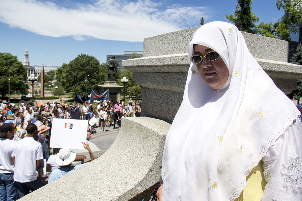 Fatemeh Shamsuddini, a refugee from Afghanistan, stands on the Capitol steps on World Refugee Day, June 20, 2017. (Kevin J. Beaty/Denverite)  denver; denverite; world refugee day; colorado; kevinjbeaty; capitol hill; rally;
