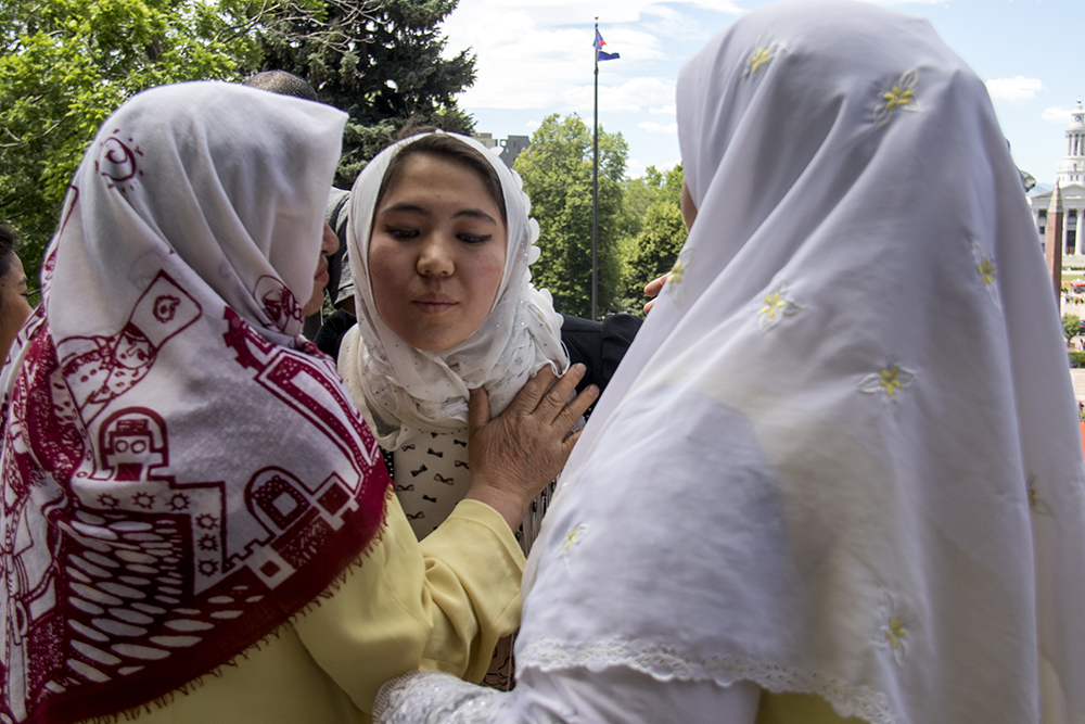 Daniella Mohammadi kisses her mother after addressing the crowd. World Refugee Day, June 20, 2017. (Kevin J. Beaty/Denverite)  denver; denverite; world refugee day; colorado; kevinjbeaty; capitol hill; rally;