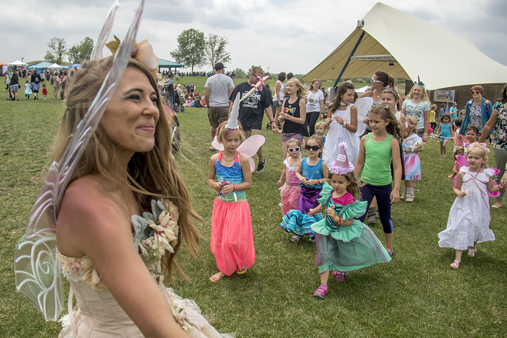 The fairy queen leads a group of smaller fairies on a parade through the festival. The first-annual Unicorn Festival in Clement Park, Littleton. (Kevin J. Beaty/Denverite)  colorado; kevinjbeaty; unicorn festival; denverite; littleton; whimsy; summer;