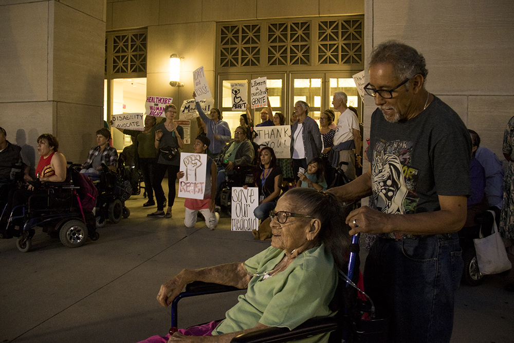 Supporters begin to protest as activists who were arrested for occupying Sen. Cory Gardner's office remain unreleased from the Denver Downtown Justice Center. (Kevin J. Beaty/Denverite)  healthcare; trumpcare; protest; denver justice center; jail; kevinjbeaty; denverite; denver; colorado;