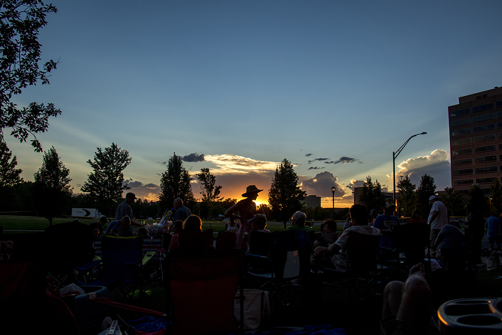 Katy Angello stands as a silhouette as the crowd waits for dusk and the fireworks to begin. The Glendale 4th of July fireworks show, July 1, 2017. (Kevin J. Beaty/Denverite)  denver; colorado; kevinjbeaty; denverite; fourth of july; 4th of july; july 4th; july fourth; independence day; glendale; fireworks; weather; cowx; dusk; cloud porn; sunset;
