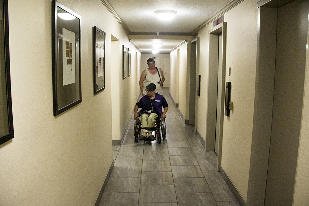 Aaron Walbert and his mother Renee at home in Capitol Hill, July 6, 2017. (Kevin J. Beaty/Denverite)  healthcare; medicaid; denver; capitol hill; denverite; colorado; kevinjbeaty; disability;