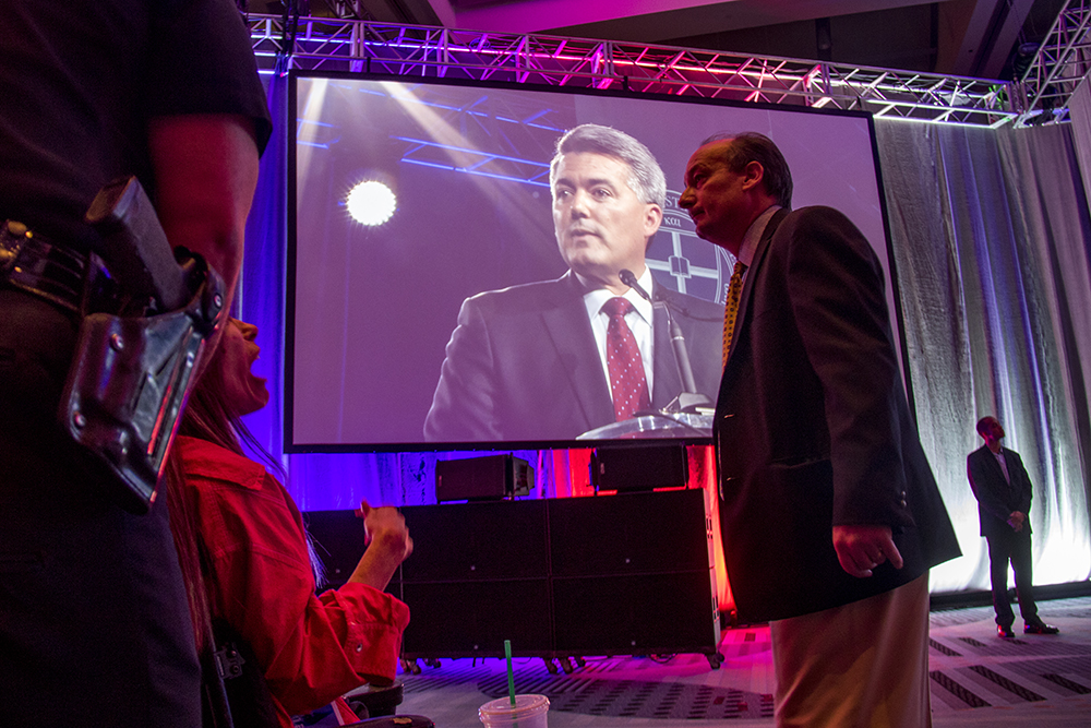 Dawn Russell interrupts Cory Gardner's speech at the Western Conservative Summit, July 21, 2017. (Kevin J. Beaty/Denverite)  western conservative summit; wcs; protest; cory gardner; healthcare; adapt; medicaid; denver; denverite; kevinjbeaty;