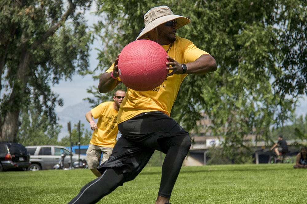 Former Bronco Tatum Bell plays kickball. The 420 Games at Berkeley Lake Park, July 22, 2017. (Kevin J. Beaty/Denverite)  420 games; Berkeley Lake Park; berkely; kevinjbeaty; denver; denverite; colorado; kickball; sports;