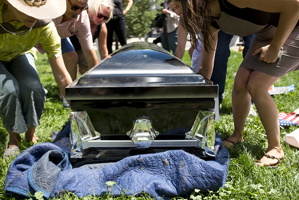 Protesters carry a casket through Skyline Park. An ADAPT protest against yet another healthcare bill in Washington that could strip Medicaid coverage. Skyline Park, July 27, 2017. (Kevin J. Beaty/Denverite)  adapt; healthcare; denver; colorado; denverite; skyline park; medicaid; kevinjbeaty;