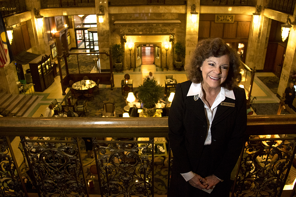 The Brown Palace Hotel's historian Debra Faulkner poses for a photo above tea time, Aug. 3, 2017. (Kevin J. Beaty/Denverite)