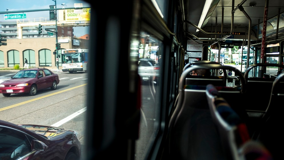 Capitol Hill seen from a number 15 RTD bus on Colfax, Aug. 11, 2017. (Kevin J. Beaty/Denverite)  rtd; bus; colfax; denver; colorado; transportation; kevinjbeaty; denverite; capitol hill; capitol building; gold dome;