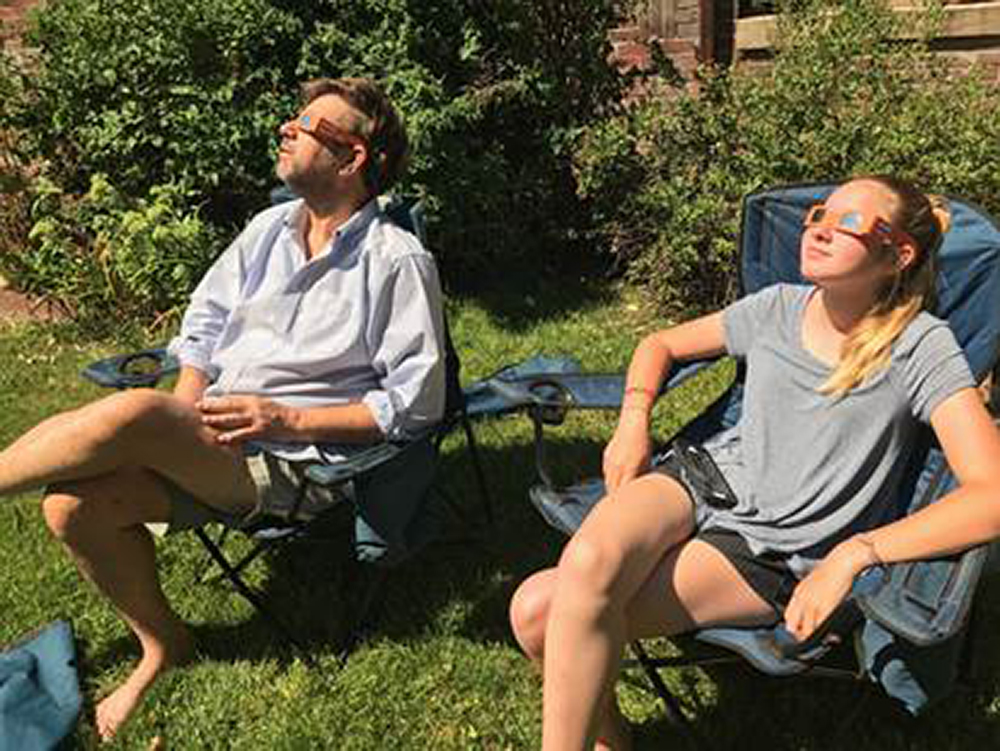 Kickin' back at the eclipse in Park Hill. (Submitted by reader Anne Parsons)