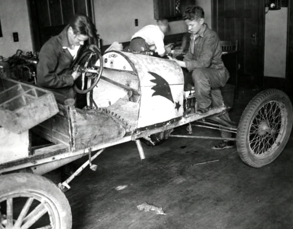 Boys working on a roadster during an auto shop class at West High School. (Denver Public Library/Western History Collection/WH1990)  high school; denver public library; dpl; archive; history;