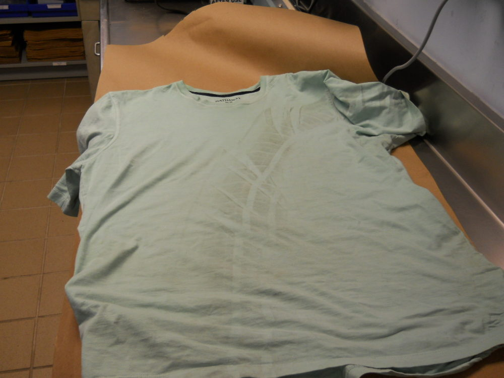 A tire track left on a man's shirt after he was run over in a Wheat Ridge parking lot. (Wheat Ridge Police Department)