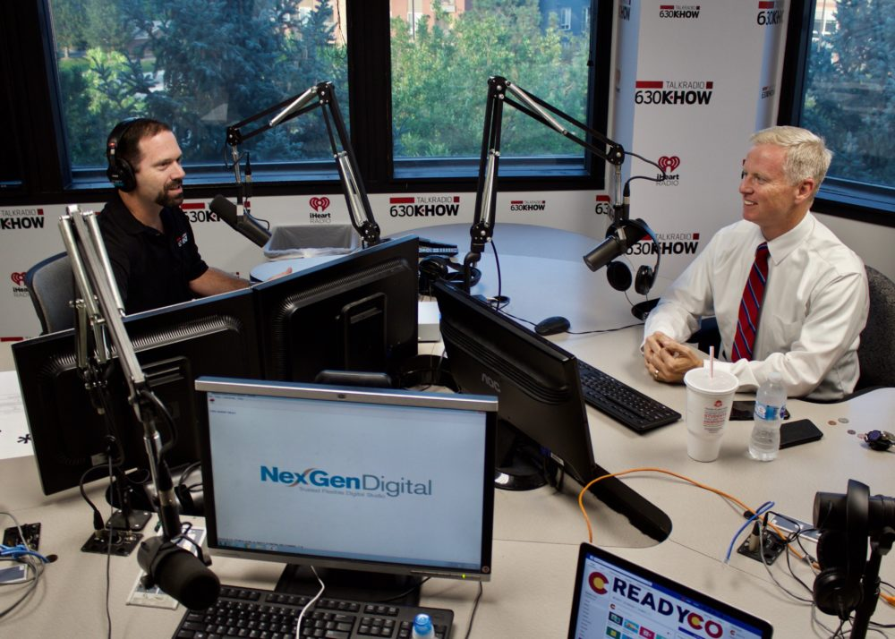 Radio host Ross Kaminsky, left, and Republican gubernatorial candidate George Brauchler before a telephone town hall Aug. 29. (Nic Garcia/Chalkbeat)