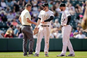 Nolan Arenado avoided serious injury after a ground ball hit his hand. (Isaiah J. Downing/USA Today Sports)