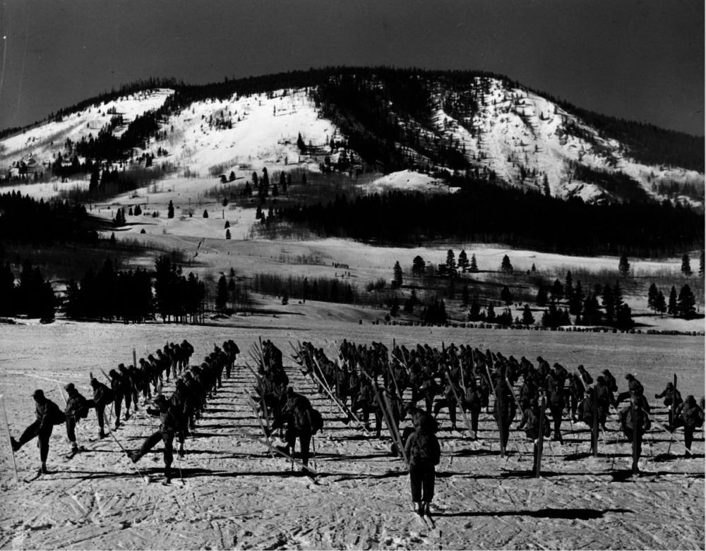 """Soldiers from the Tenth Mountain Division, 87th Mountain Infantry Regiment doing an about-face near Camp Hale in Colorado during filming of """"The Fighting Mountaineers"""" in 1943 or '44. (Mac Julian/Western History & Genealogy Dept./Denver Public Library)"""