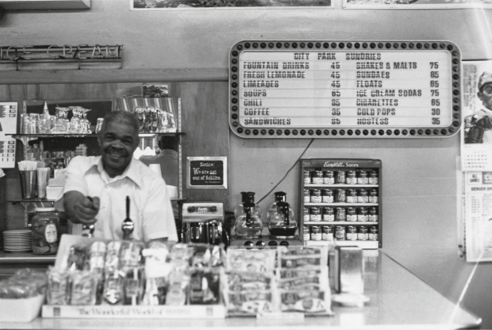 Ferris Cassius, the proprietor of City Park Sundries, draws a soda at his business at 2101 York Street in 1976. (Thomas Noel/Western History & Genealogy Dept./Denver Public Library)