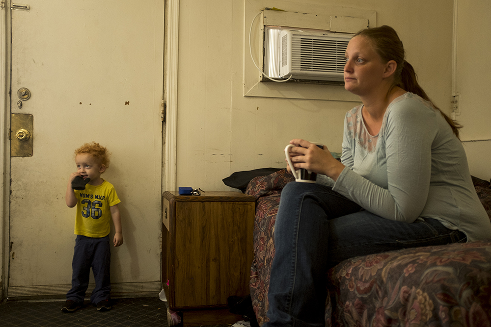 Ashley Angel and her son, Kayden, inside the Carriage Motor Inn where they've been living for two and a half months, Sept. 27, 2017. (Kevin J. Beaty/Denverite)  denver; colorado; denverite; kevinjbeaty; motel; colfax; affordable housing;