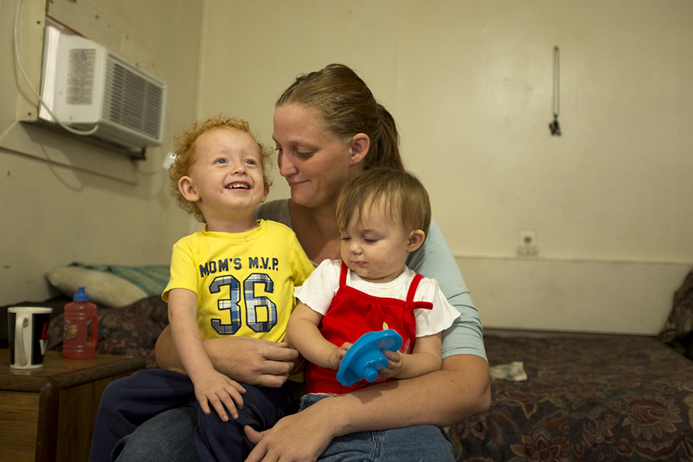 Ashley Angel and her son, Kayden, and daughter, Saydia, inside the Carriage Motor Inn where they've been living for two and a half months, Sept. 27, 2017. (Kevin J. Beaty/Denverite)  denver; colorado; denverite; kevinjbeaty; motel; colfax; affordable housing;