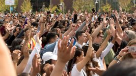 Students raise their hands to show that they know someone who has been deported. Thousands walked out of class to attend a rally on the Auraria campus in response to the repeal of DACA, Sept. 5, 2017. (Kevin J. Beaty/Denverite)  daca; undocumented; immigration; tivoli student union; auraria campus; rally; protest; walkout; kevinjbeaty; denver; denverite; colorado;