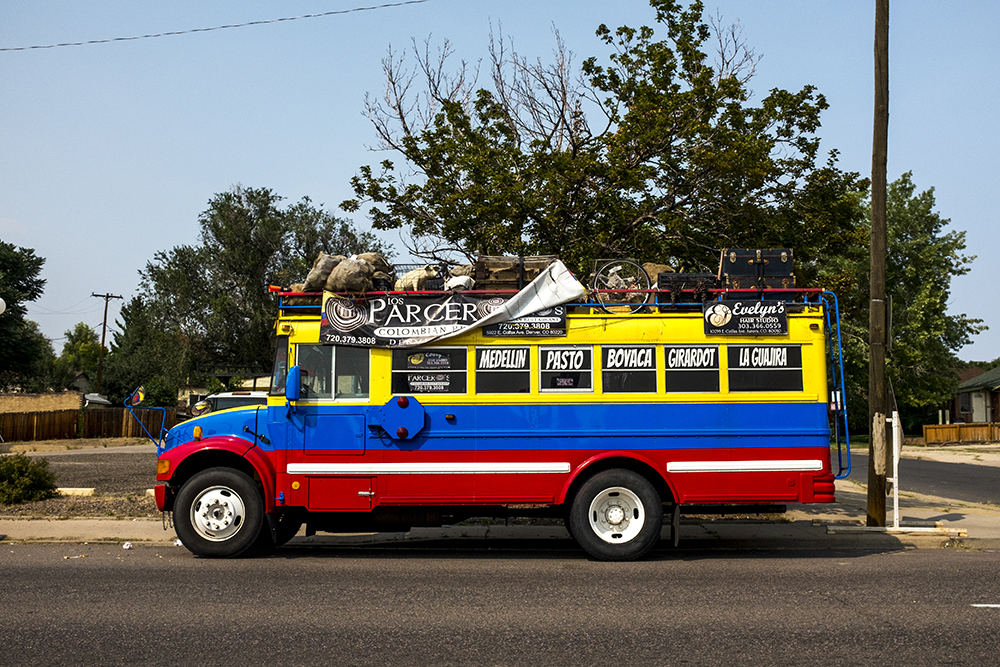 A bus affiliated with Los Parceros Colombian Restaurant parked on East Colfax Avenue, Sept. 7. 2017. (Kevin J. Beaty/Denverite)