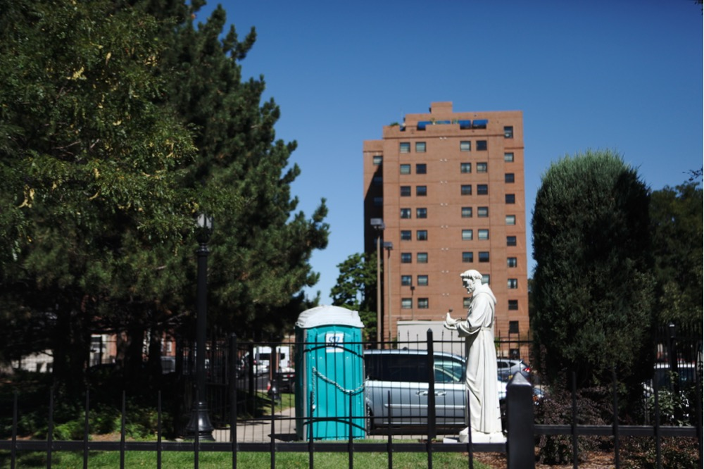 A statue outside Cathedral Basilica on East Colfax. (Andrew Kenney/Denverite)