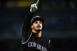 Nolan Arenado points to the crowd after blasting his 37th home run of the season. (Ron Chenoy/USA Today Sports)