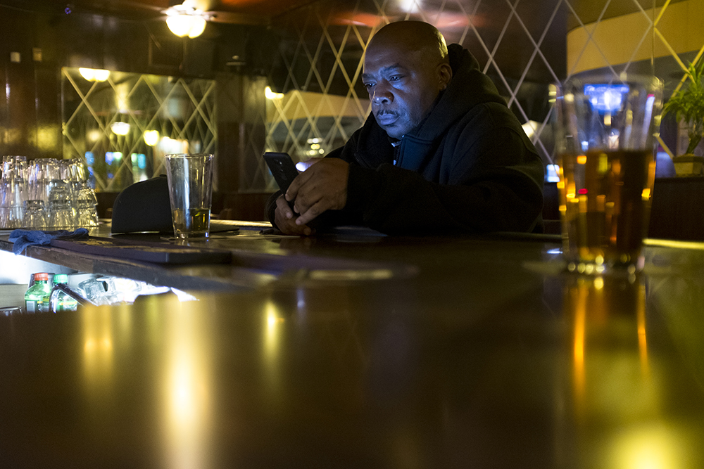 Juan Miner from Aurura has a beer at the bar on a Tuesday night at Nob Hill, East Colfax Avenue. (Kevin J. Beaty/Denverite)  denver; colorado; denverite; kevinjbeaty; bars; nightlife; east colfax; capitol hill;