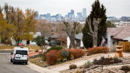 The Denver skyline seen beyond an Athmar Park home. (Kevin J. Beaty/Denverite)  kevinjbeaty; denverite; denver; colorado; athmar park; residential real estate;