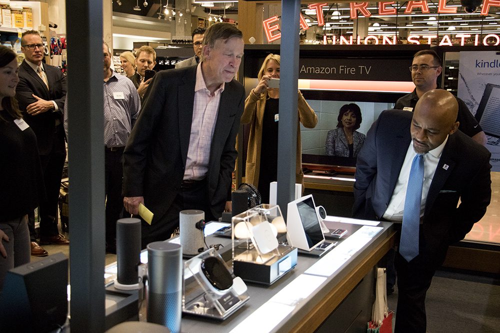 Mayor Michael Hancock and Governor John Hickenlooper tour an Amazon pop-up store inside the new Whole Foods Market near Union Station, Nov. 13, 2017. (Kevin J. Beaty/Denverite)  whole foods; grocery store; union station; denver; denverite; kevinjbeaty; colorado; mayor michael hancock; john hickenlooper;