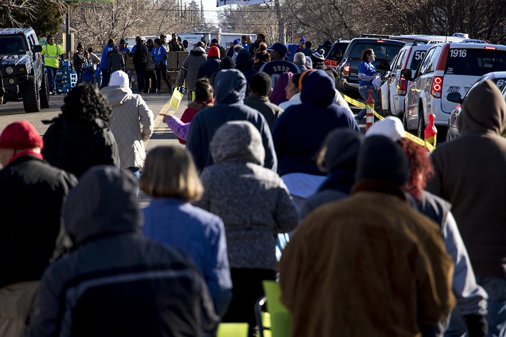 Turkey box recipients line up in droves. The Epworth Foundation's annual Feed a Family Thanksgiving dinner giveaway, Nov. 18, 2017. (Kevin J. Beaty/Denverite)  denver; colorado; denverite; kevinjbeaty; cole; thanksgiving; food pantry; food insecurity;
