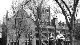 Women walk with books at Loretto Heights Colleges in Denver, Colorado. The rusticated stone building with stone tower and arcades was designed by Frank E. Edbrooke sometime between 1948 and 1960.  (Lloyd Rule, Denver Public Library Western History Collection, 	Z-10327)