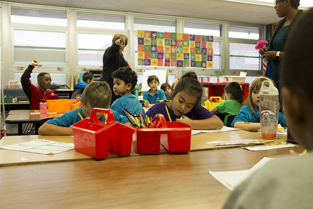 First graders work on writing exercises at Goldrick Elementary School, Dec. 7, 2017. (Kevin J. Beaty/Denverite)  denver; colorado; denverite; kevinjbeaty; elementary school; education; goldrick elementary; learning; classroom;