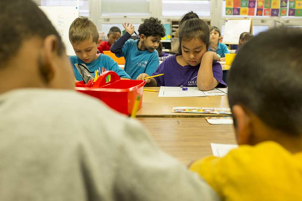 First graders work on writing exercises at Goldrick Elementary School, Dec. 7, 2017. (Kevin J. Beaty/Denverite)