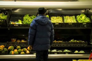 A shopper peruses fresh, maybe ugly, vegetables at Metro Caring food pantry in City Park West. A ride-along with We Don't Waste, Dec. 18, 2017 (Kevin J. Beaty/Denverite)  denver; colorado; denverite; food insecurity; food; sustainability;