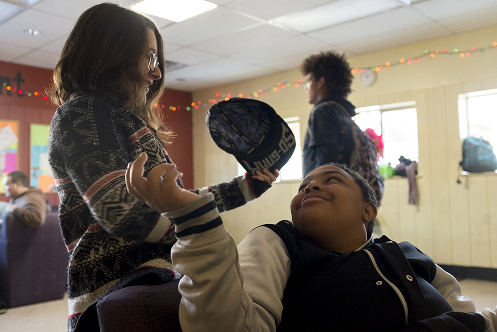 Zee, 20, chats with case worker Theresa Marten. Christmas Day at Urban Peak, a shelter for Denver's homeless youth, Dec. 25, 2017. (Kevin J. Beaty/Denverite)  homeless; urban peak; denver; denverite; colorado; kevinjbeaty;