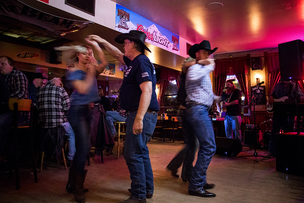 Cassie Gibbs (left) dances with Bob Gunning at the Stock Yards Saloon on the National Western Stock Show's opening night, Jan. 11, 2018. (Kevin J. Beaty/Denverite)   country bar; bars; nightlife; music; country music; kevinjbeaty; denver; denverite; colorado;