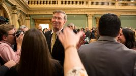 Governor John Hickenlooper shakes hands with legislators after his State of the State address, Jan. 11, 2017. (Kevin J. Beaty/Denverite)